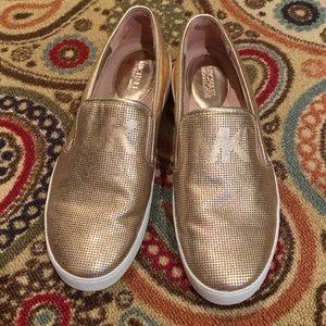Rose gold Michael Kora slip on tennis shoes